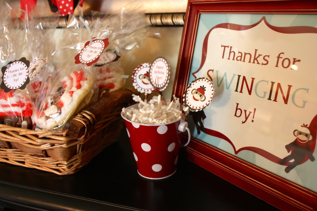 The printable were from Designing for Peanuts, as were the toppers in red and white polkadot metal buckets. The party favors were sock monkey sugar cookies in bags with red and black printables tied on with ribbon.