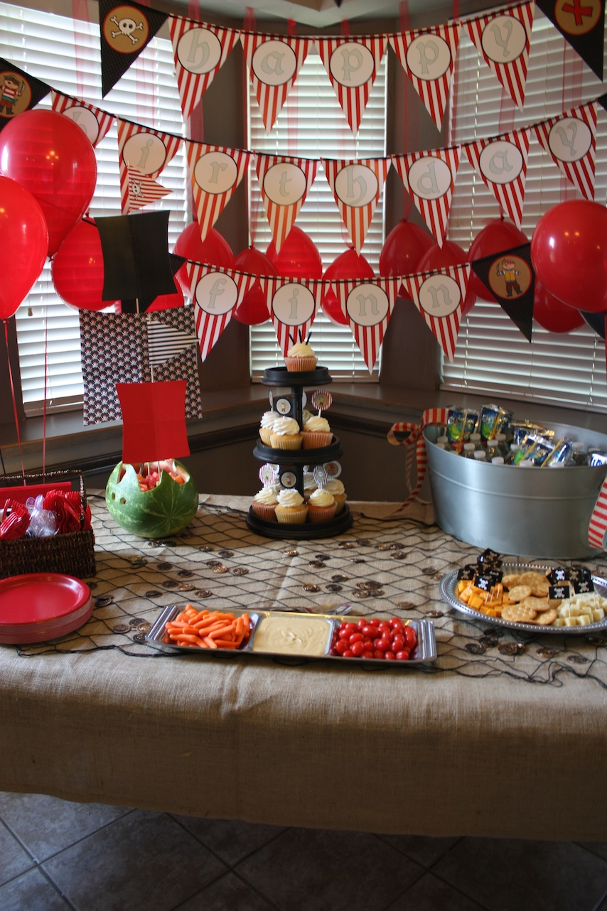 Pirate themed party food snack table laden goodies.