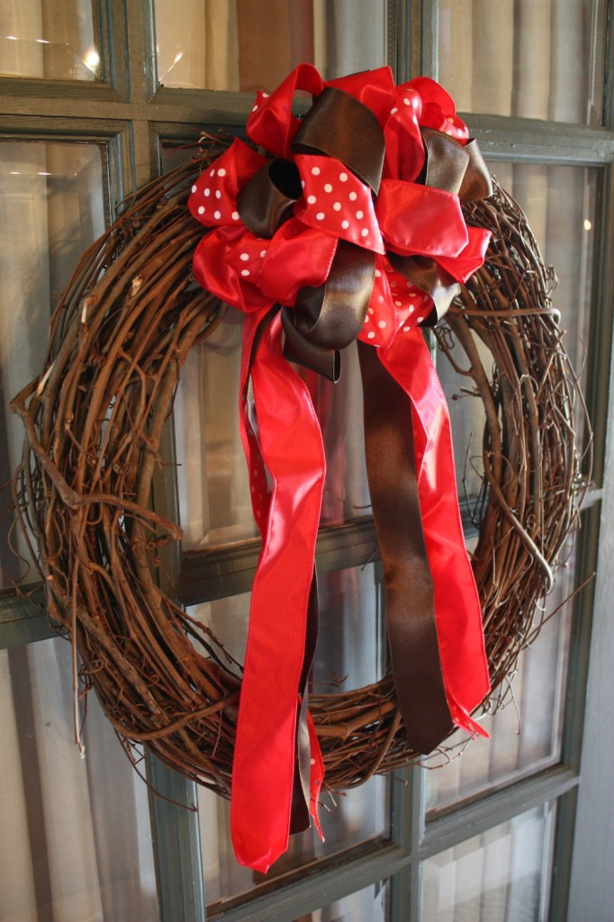 Red and black ribbon on a wreath